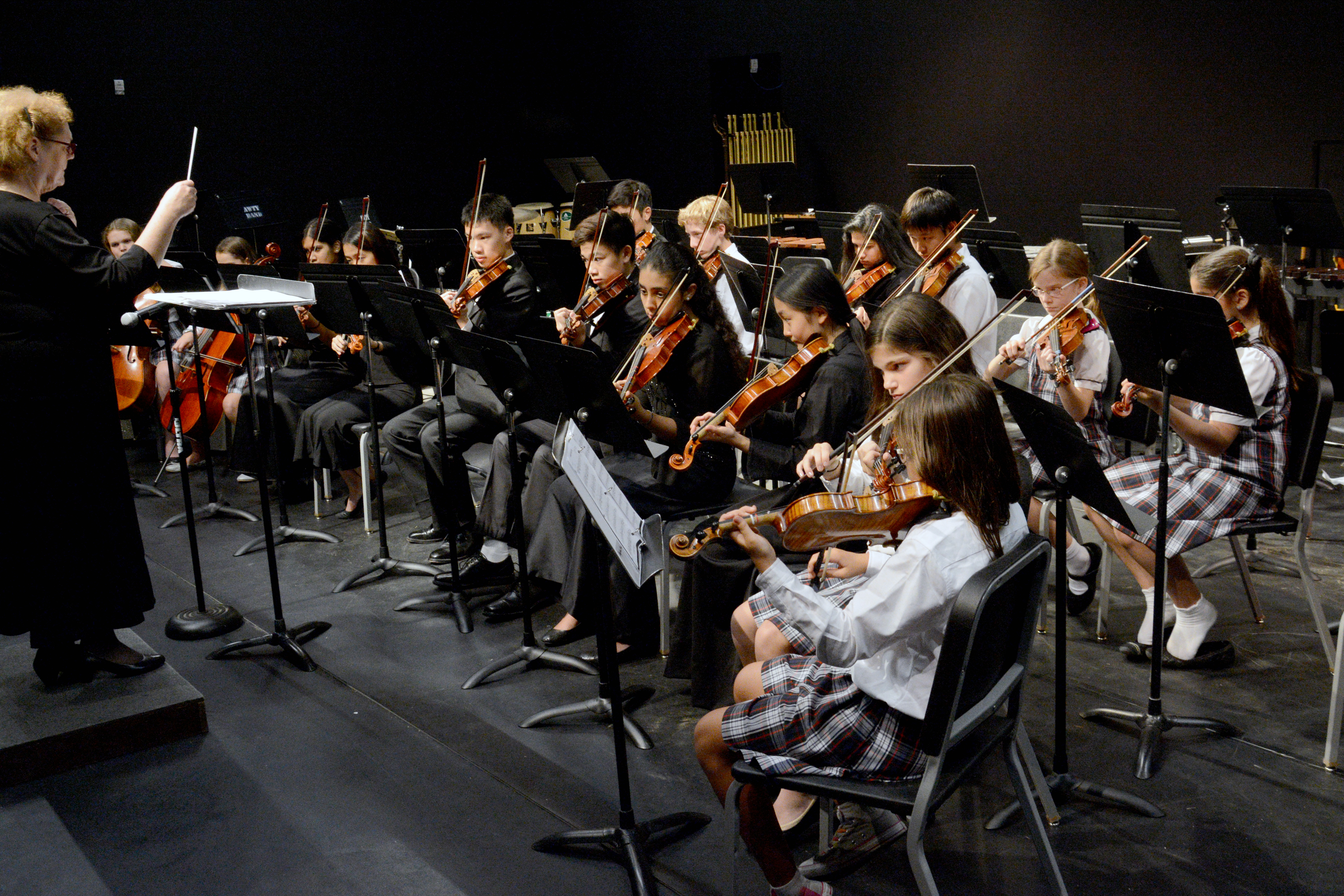 awty orchestra playing on stage