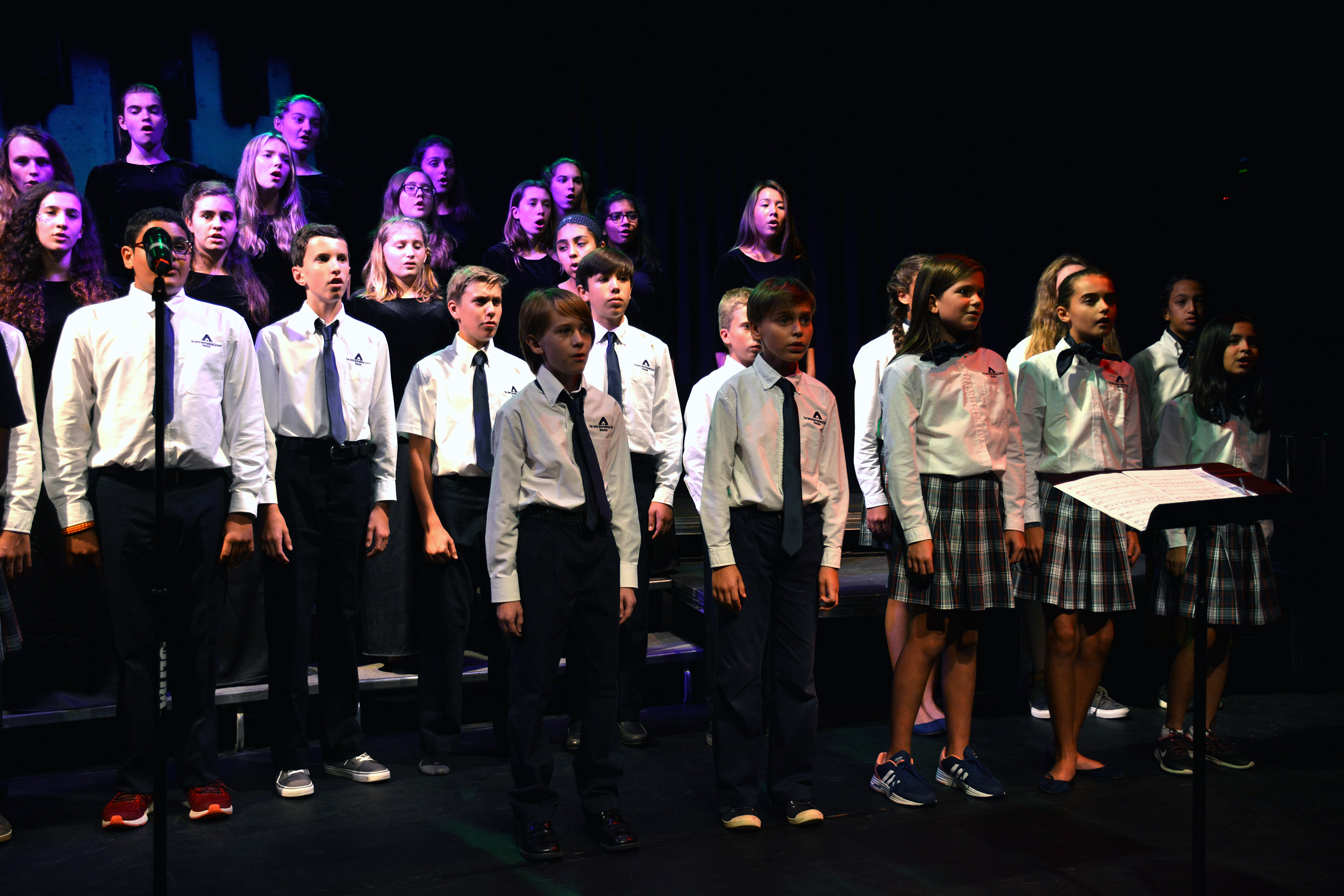 Awty choir kids singing on stage